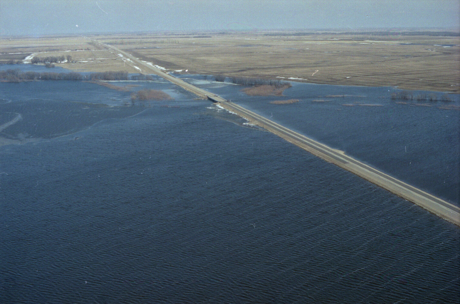 A bridge on the road shows where the river would normally by, in this view from the air taken during the 1995 spring floods in the Souris and Melita areas. (Dirk Aberson / Brandon Sun archives, April 12, 1995)