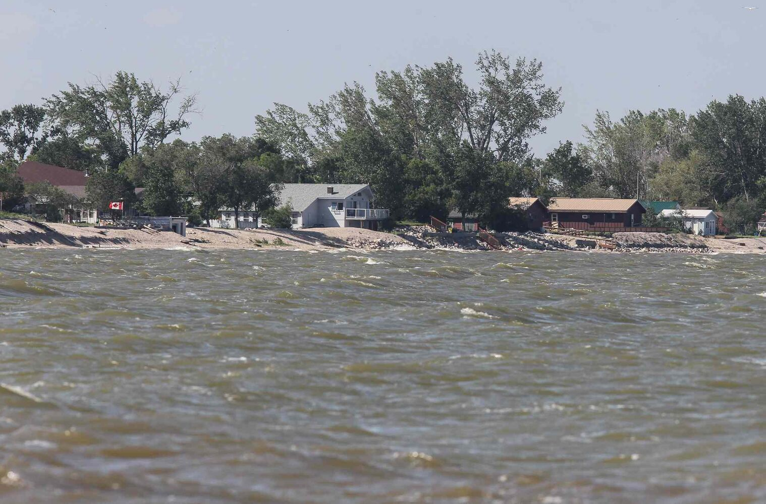 A look at the water levels along Twin Lakes Beach Sunday morning. (MIKE DEAL / WINNIPEG FREE PRESS)