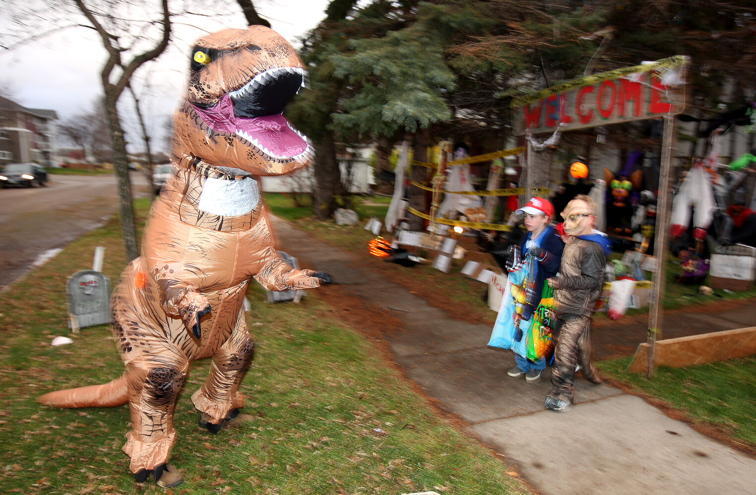 Trick-or-treaters visit the heavily decorated home of Kim and Wally Sawchuk on Fourth Street in Brandon to collect candy with friends on Halloween. (Tim Smith/Brandon Sun)