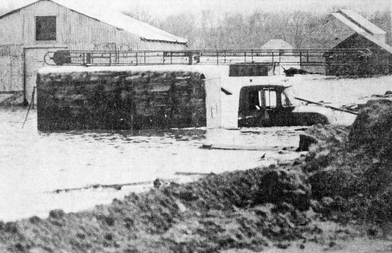 A partly-submerged truck in the Melita area outside the protection of the dike system along the Souris River. (Brandon Sun archives, April 8, 1976)