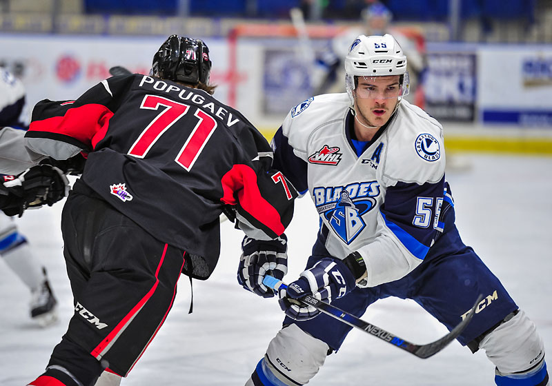Mitchell Wheaton (right) is one of two new defencemen who the Brandon Wheat Kings acquired from the Saskatoon Blades on Monday.