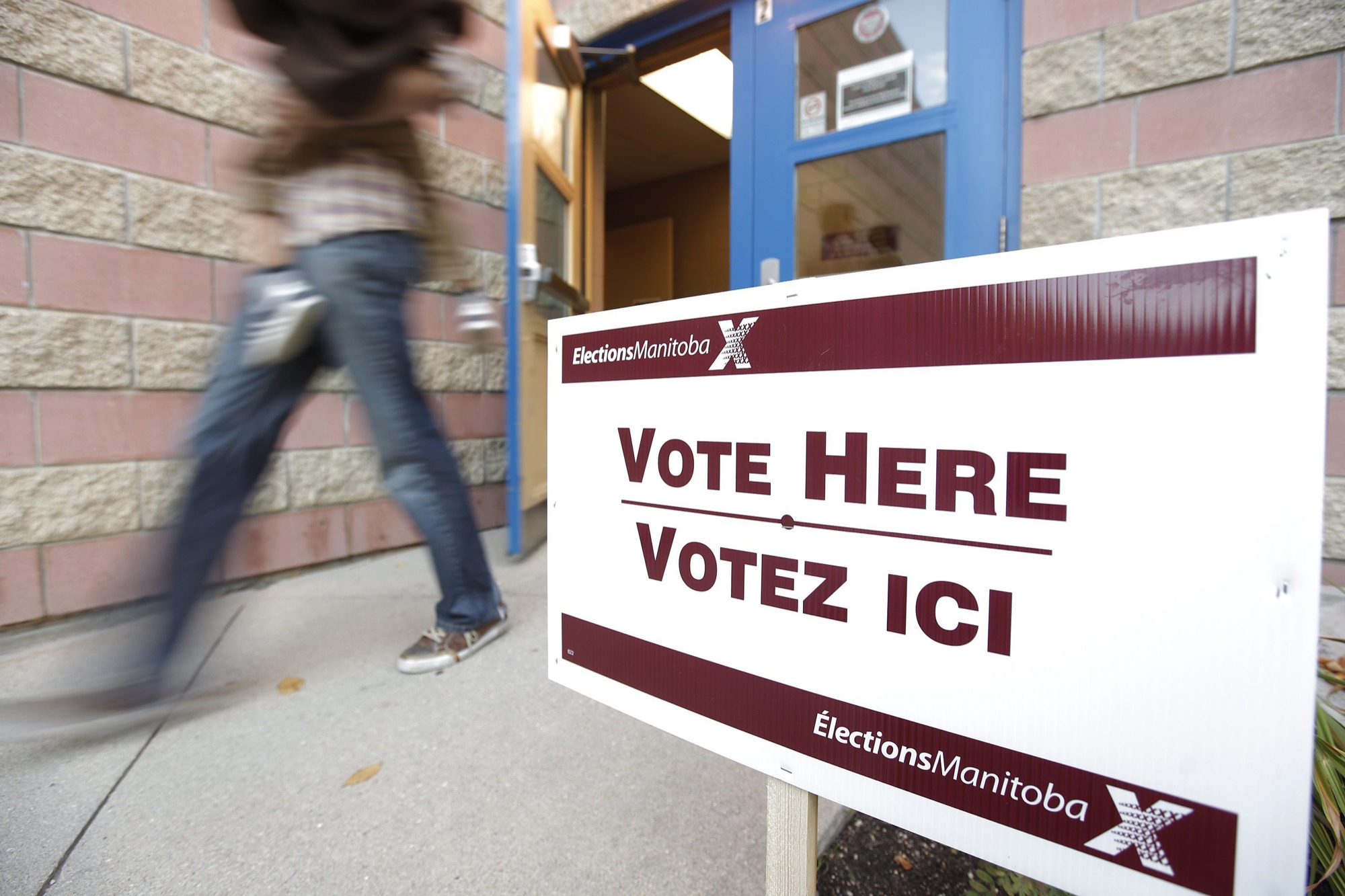 A voter walks out of a polling station in Winnipeg after voting in the October 2011 Manitoba election.