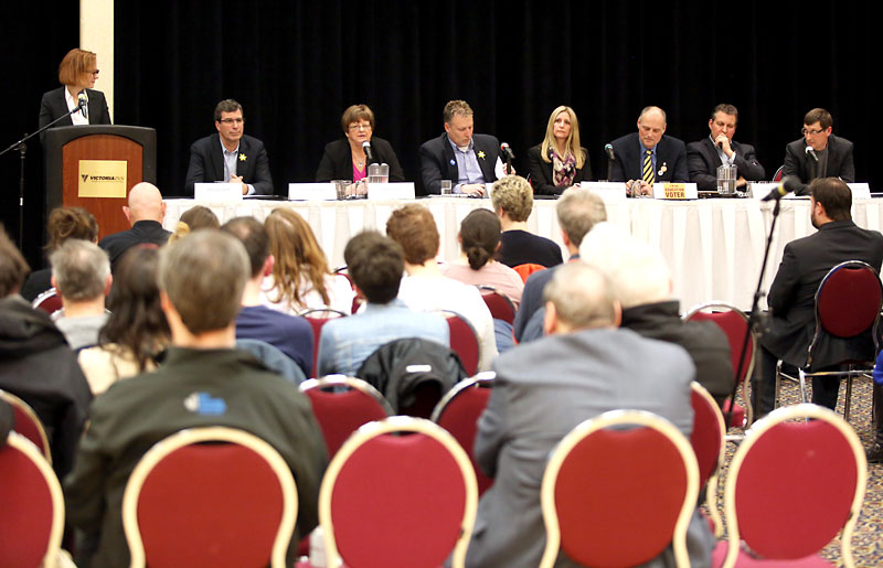 Candidates take part in the Brandon Teachers' Association/Brandon School Division debate, moderated by Brandon University political science Prof. Kelly Saunders (left), at the Victoria Inn's Imperial Ballroom on Tuesday evening. From left to right are Brandon West Progressive Conservative candidate Reg Helwer, Brandon West NDP candidate Linda Ross, Brandon East Tory candidate Len Isleifson, Brandon East Liberal candidate Vanessa Hamilton, Brandon East NDP candidate Drew Caldwell, Spruce Woods Progressive Conservative candidate Cliff Cullen and Spruce Woods Manitoba Party candidate Malcolm McKellar.