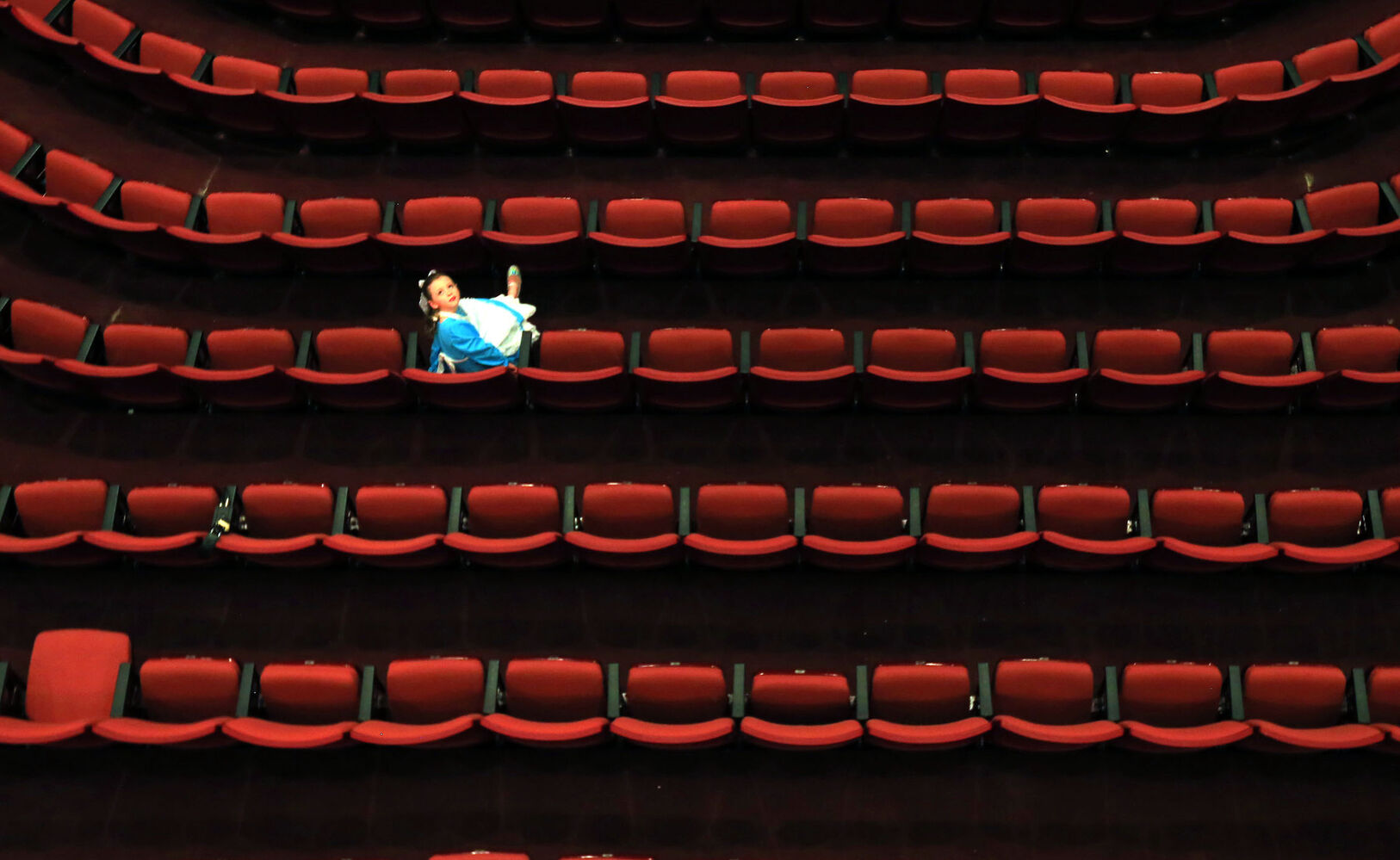 """Anya Visser takes a seat while awaiting the start of a dress rehearsal of """"Cinderella"""" at the Western Manitoba Centennial Auditorium in November. (Bruce Bumstead/Brandon Sun)"""