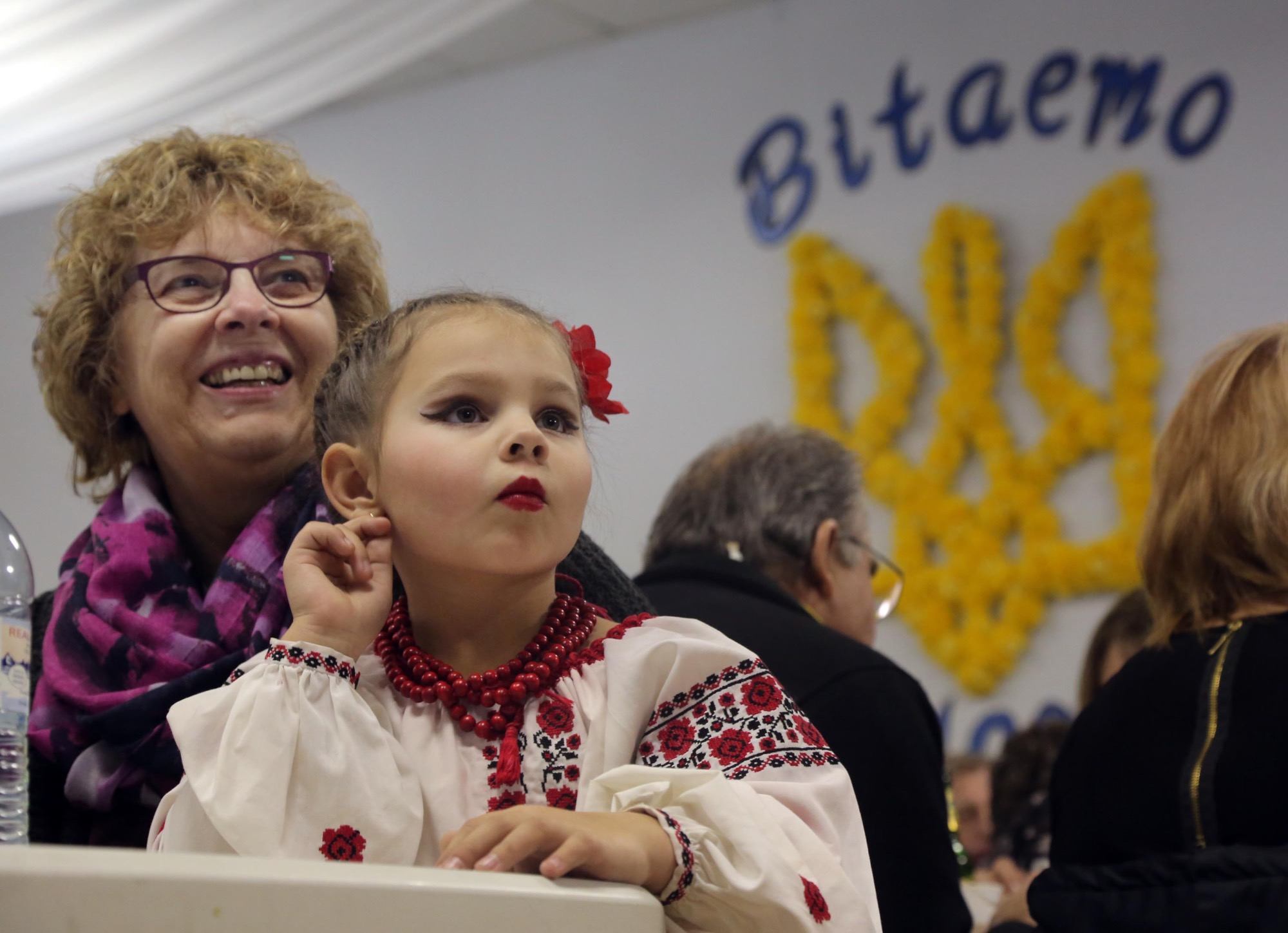 London Hrubeniuk and her baba Louise watch the opening acts at the Ukrainian pavilion during the opening night of the Westman Multicultural Festival on Thursday evening. The event runs through Saturday at seven venues throughout the city.