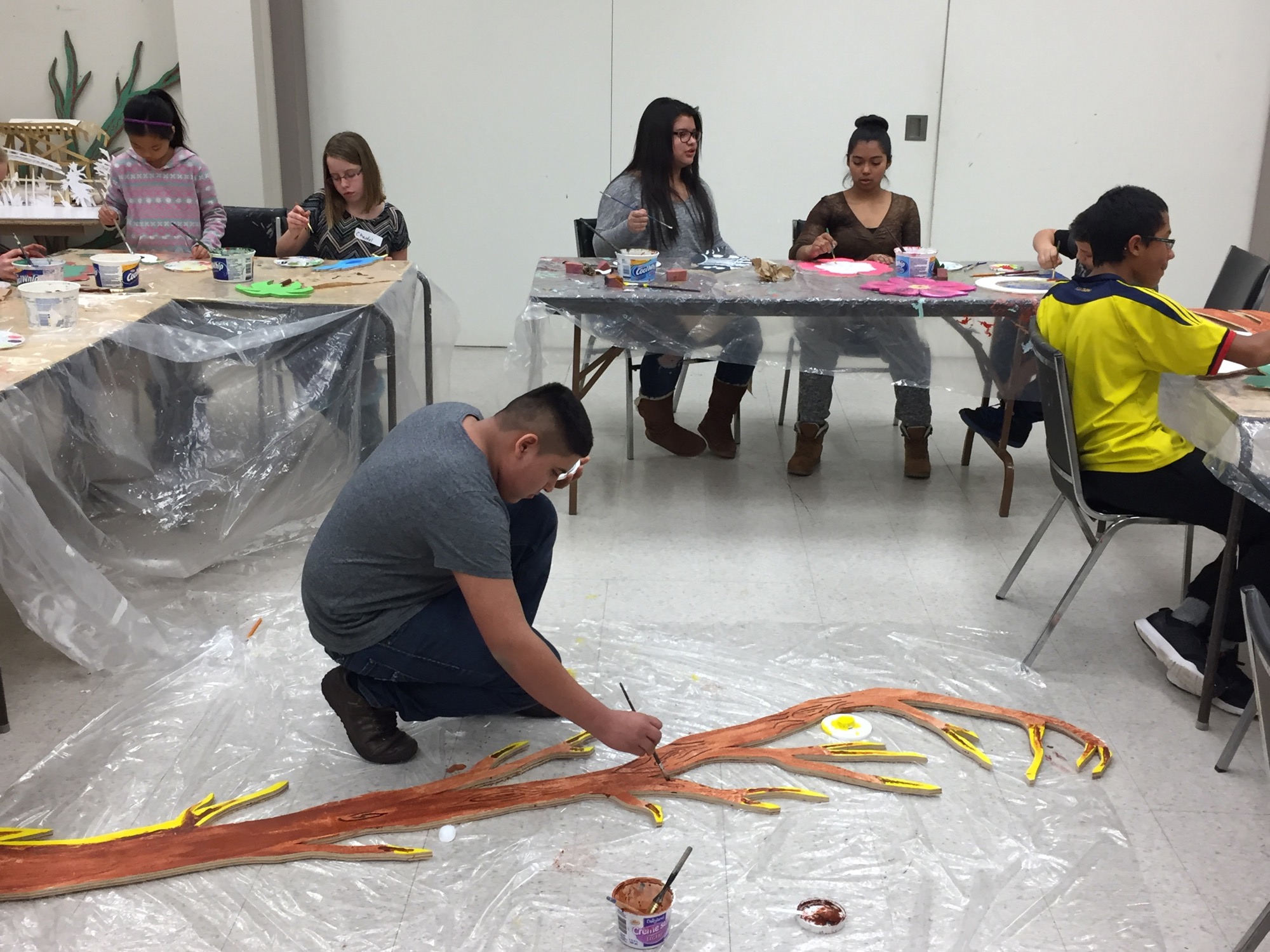 Artists prepare pieces for the Winter Gardens art project at the Art Gallery of Southwestern Manitoba.