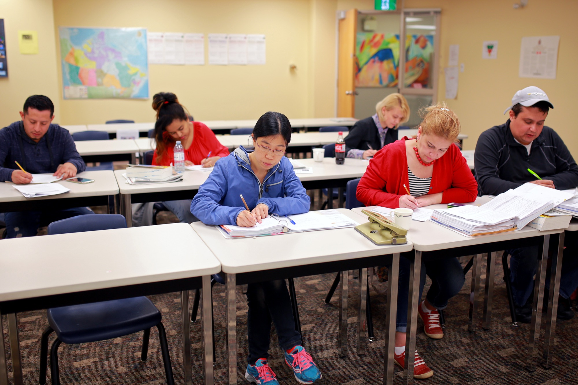 Students in a Canadian Language Benchmark Level 7-8 class at Assiniboine Community College's Adult Collegiate in downtown Brandon work on an assignment on Thursday afternoon.