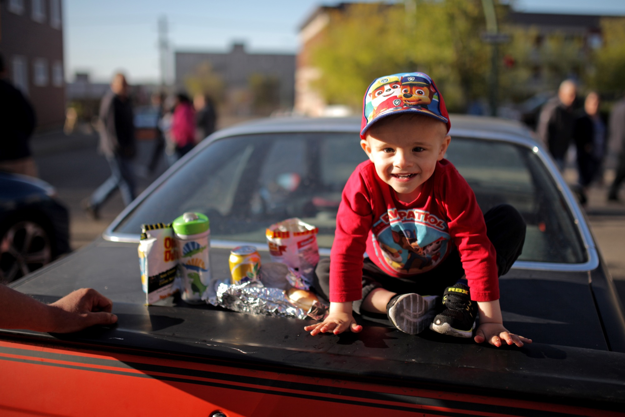 Two-year-old Conner Curtis sits atop his dad's 1991 Ford Tempo during the first Cruise Night in Downtown Brandon of the season on Thursday.