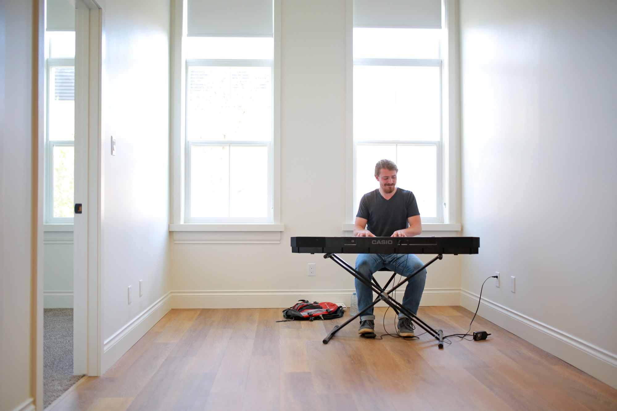 David Naylor with Brandon University's School of Music performs for guests during an open house for the Prairie Lofts apartments on the 800 block of Rosser Avenue on Thursday evening.