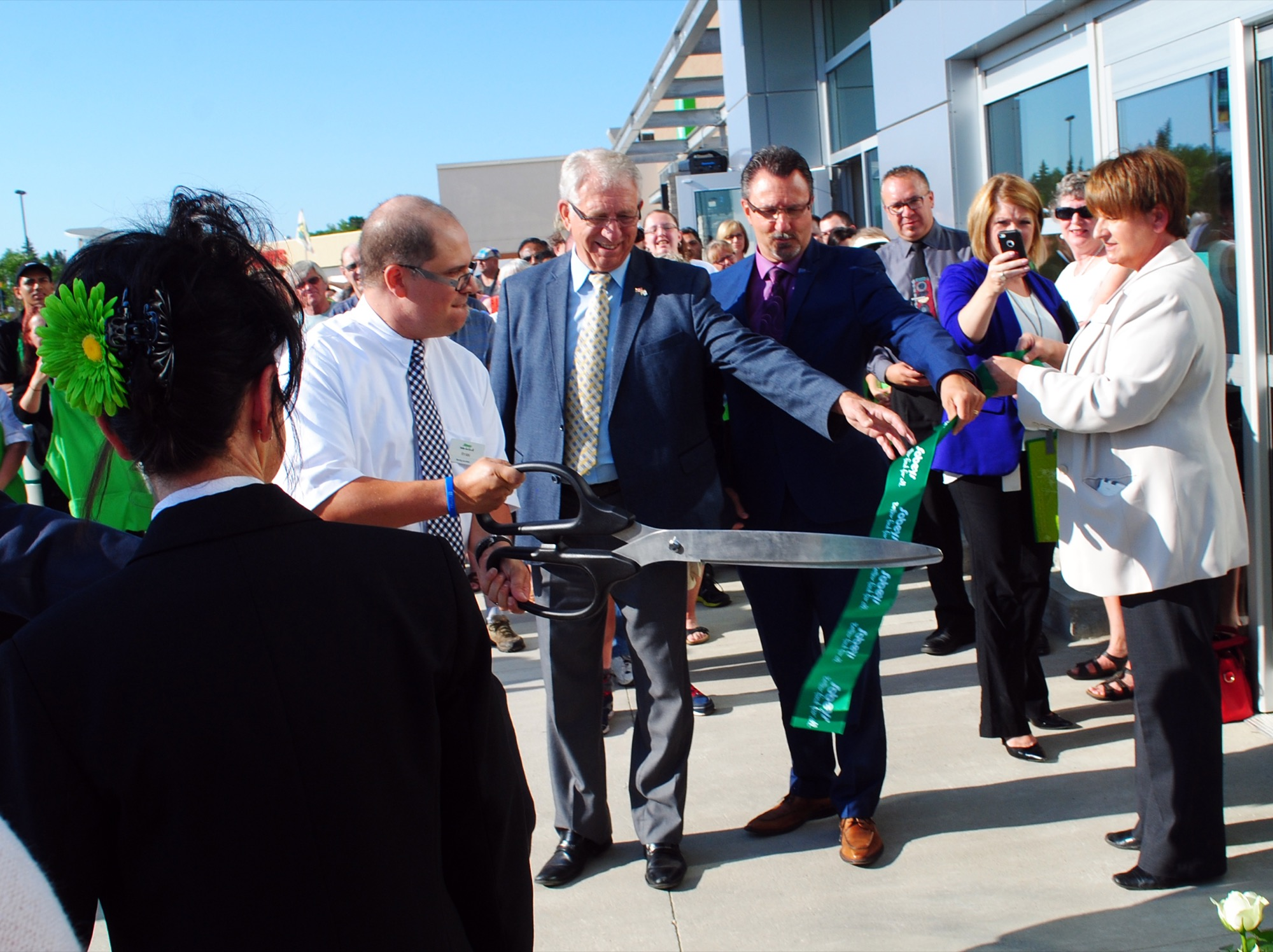 Manager Ryan Hackett cuts the ribbon to open Sobeys Extra Brandon South on Friday. Brandon-Souris Conservative MP Larry Maguire and Mayor Rick Chrest are seen holding the ribbon.