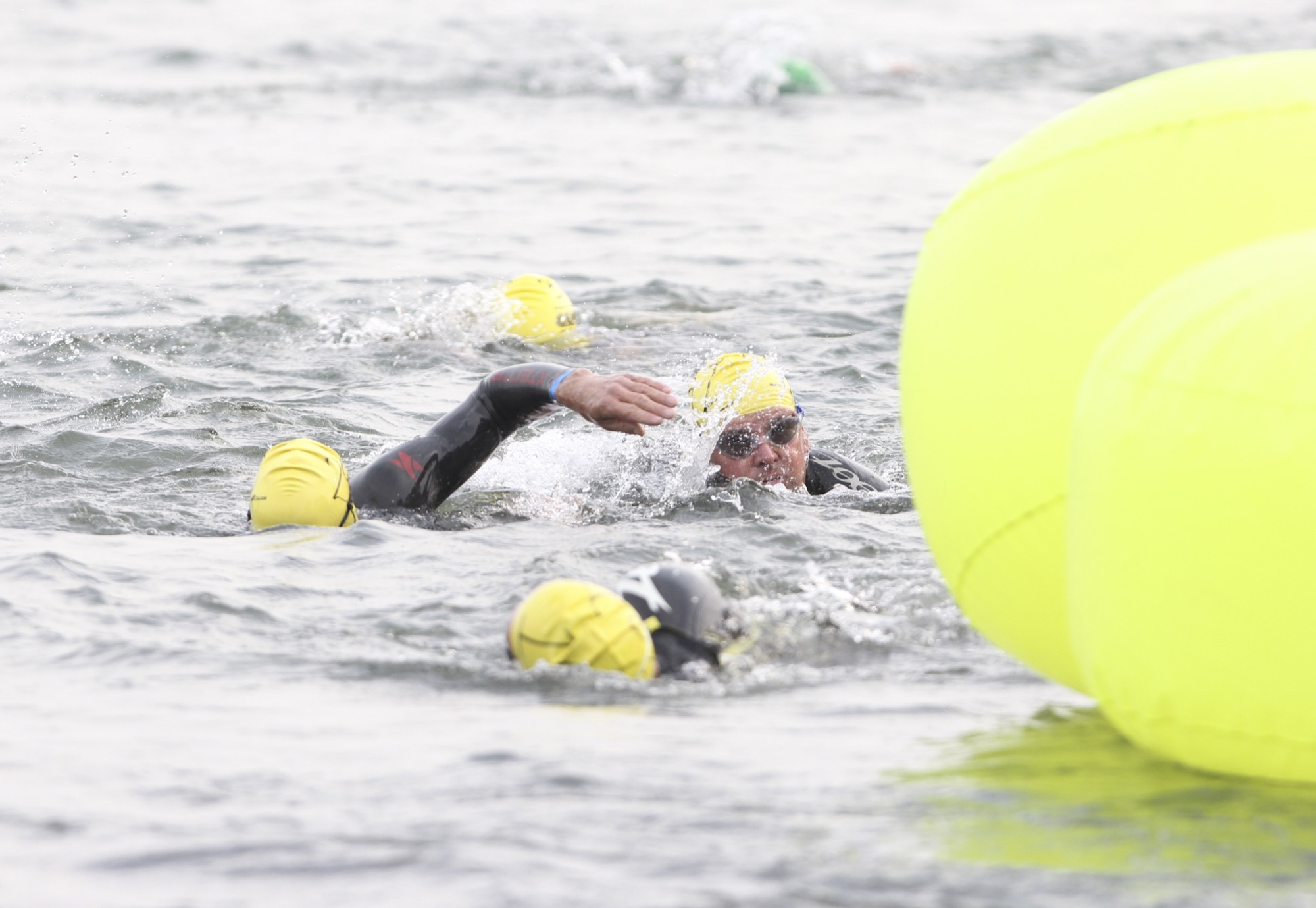Swimmers navigate thier way around the final buoy at the 31st edition of the Riding Mountain Triathlon at Wasagaming on Saturday.