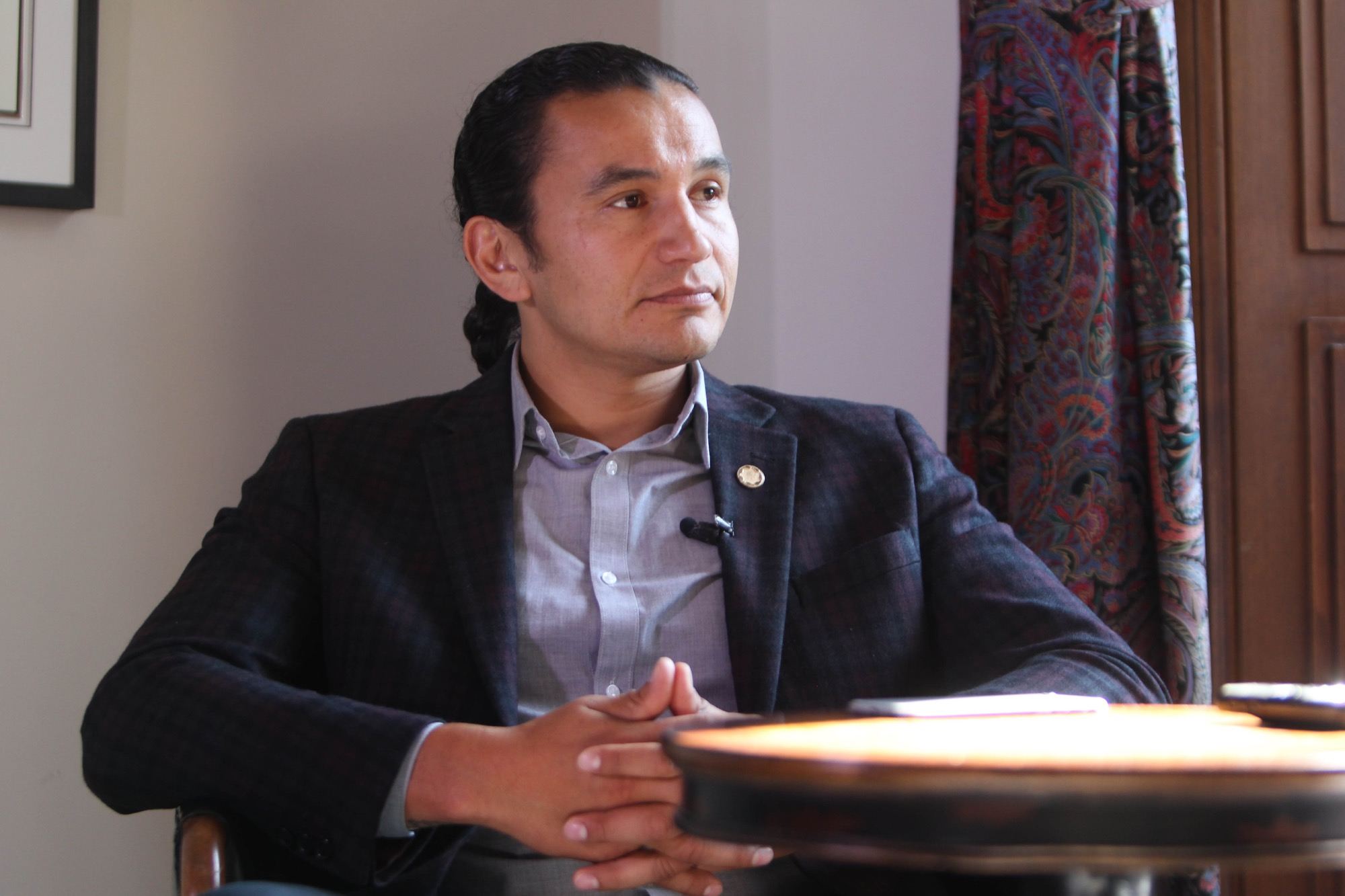 Manitoba NDP Leader Wab Kinew is seen in his new Official Opposition office while being interviewed by the Winnipeg Free Press on Sept. 18.