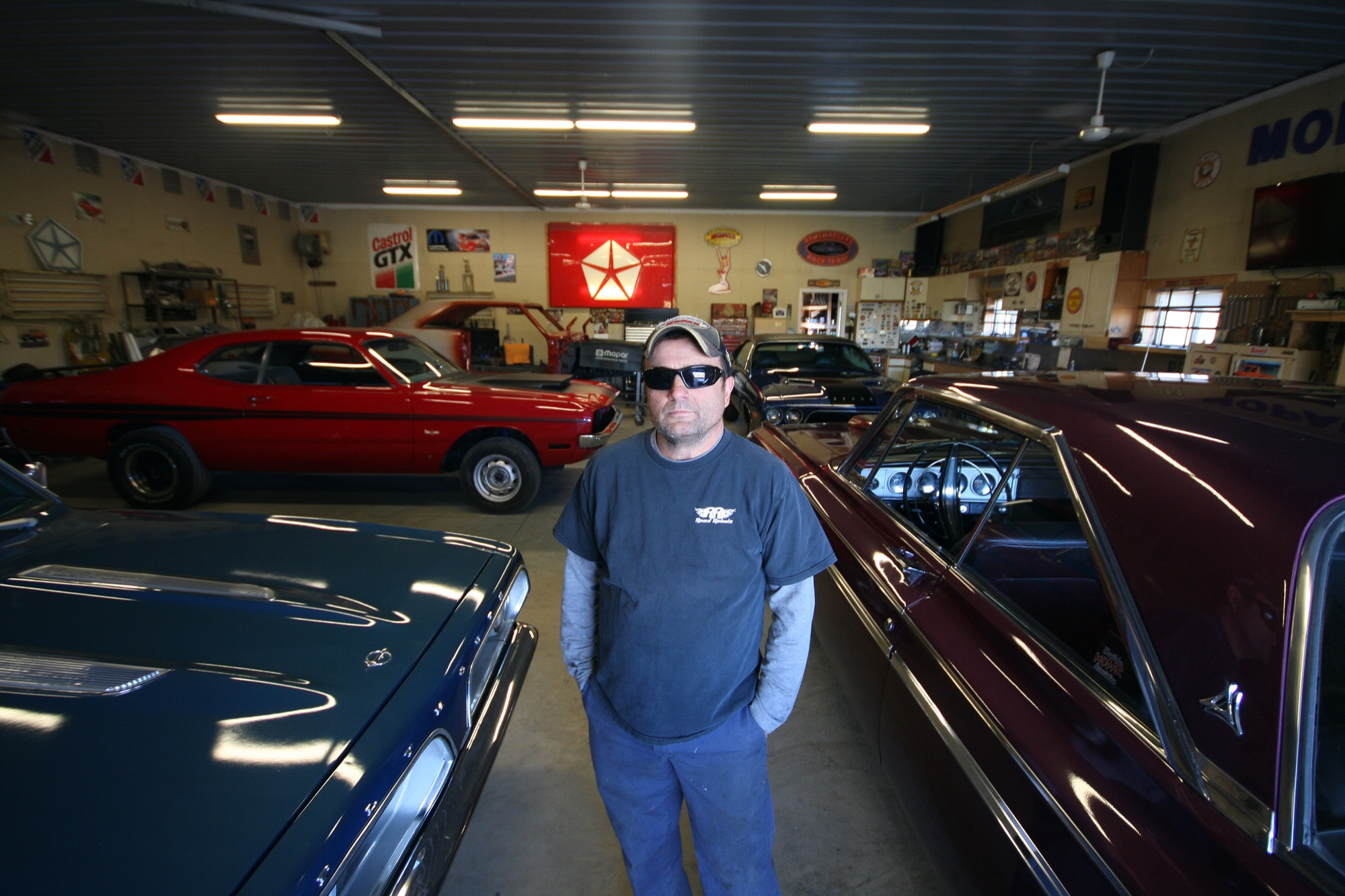 Mike Villers is seen in his expansive garage space near Shilo, where he babies his family's collection of classic cars from the '60s and '70s.