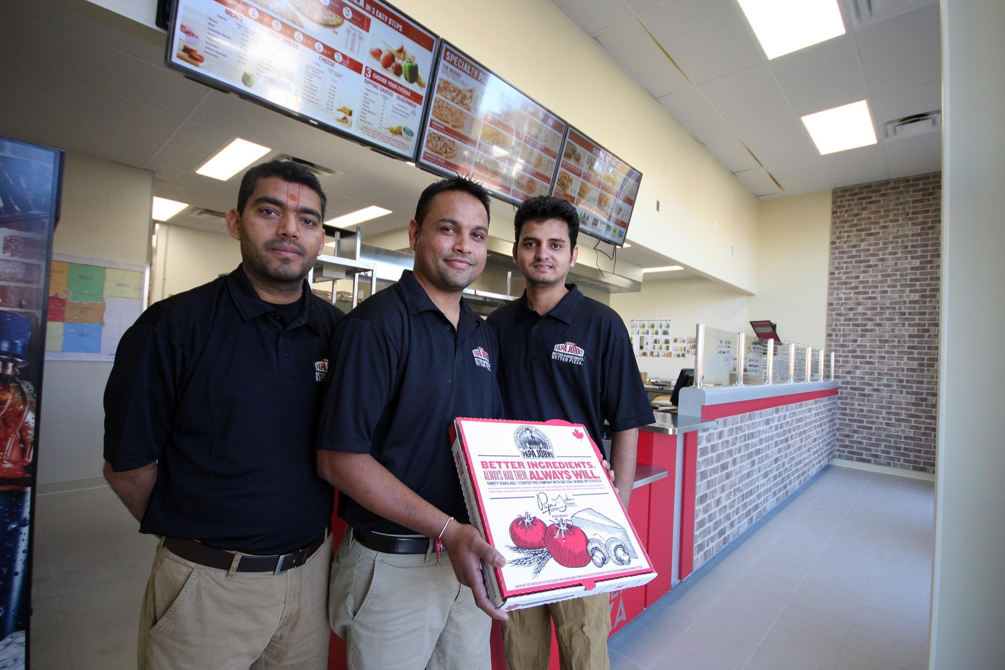 Brandon Papa John's Pizza franchise owners, from left, Gary, Parth and Prakash Patel (no relation) are seen in their new space, at the strip mall located at the northeast corner of the Rosser Avenue and 18th Street intersection.