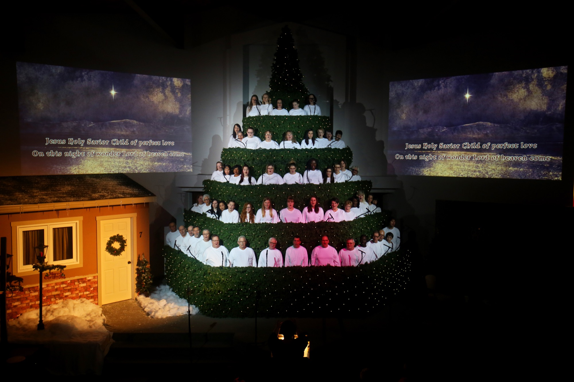 "A Singing Christmas Tree performance takes place at Calvary Temple in 2015. After a year off in 2016, the Singing Christmas Tree is back at Calvary Temple this week with ""The Christmas Calling"" — a show featuring 100 choir members from 18 churches that is designed to allow the audience to experience the meaning of the season through the characters of the first Christmas story."