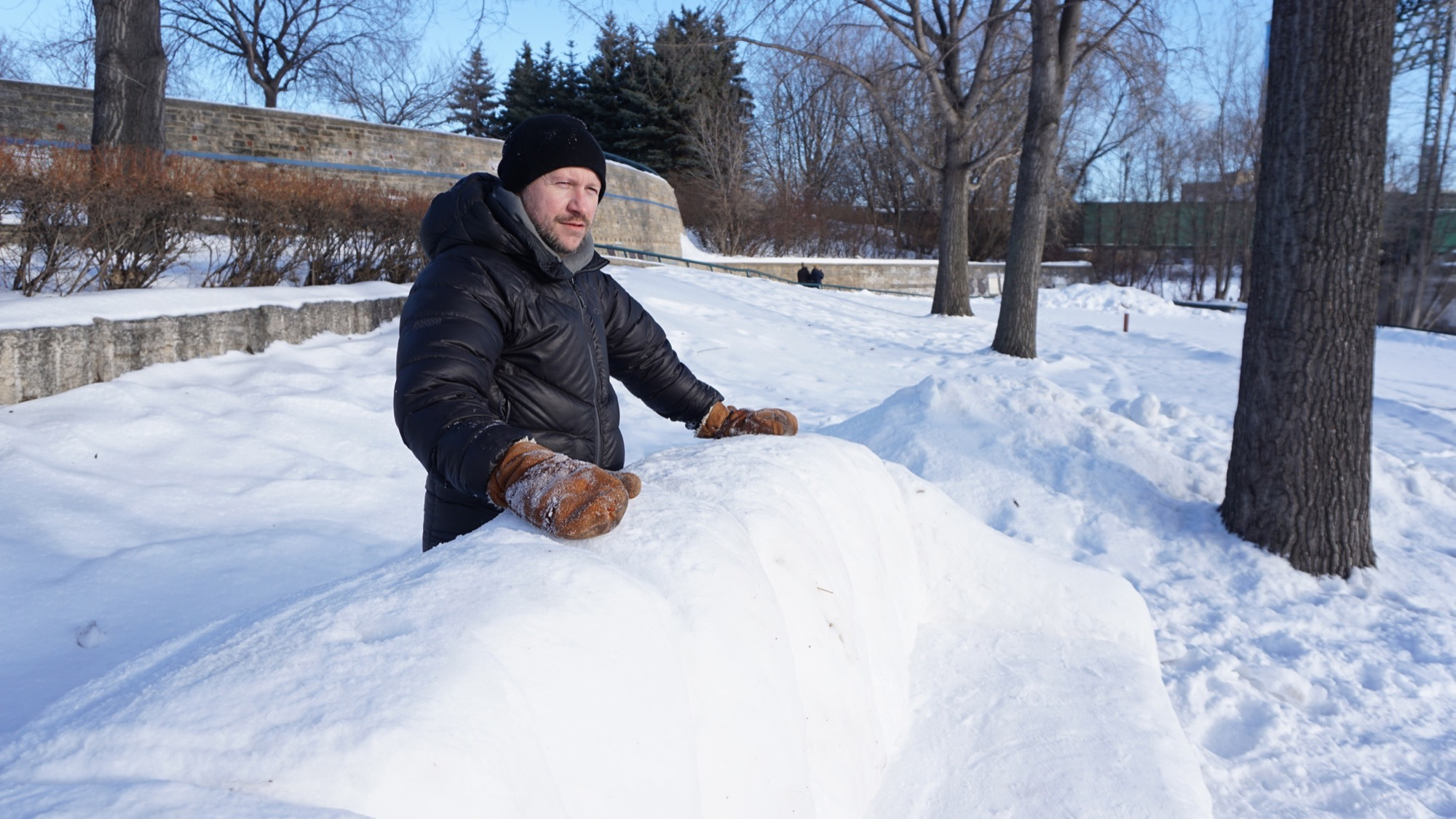 "Winnipeg artist James Culleton pictured in 2016 with one of his ""snowfas""  at The Forks."