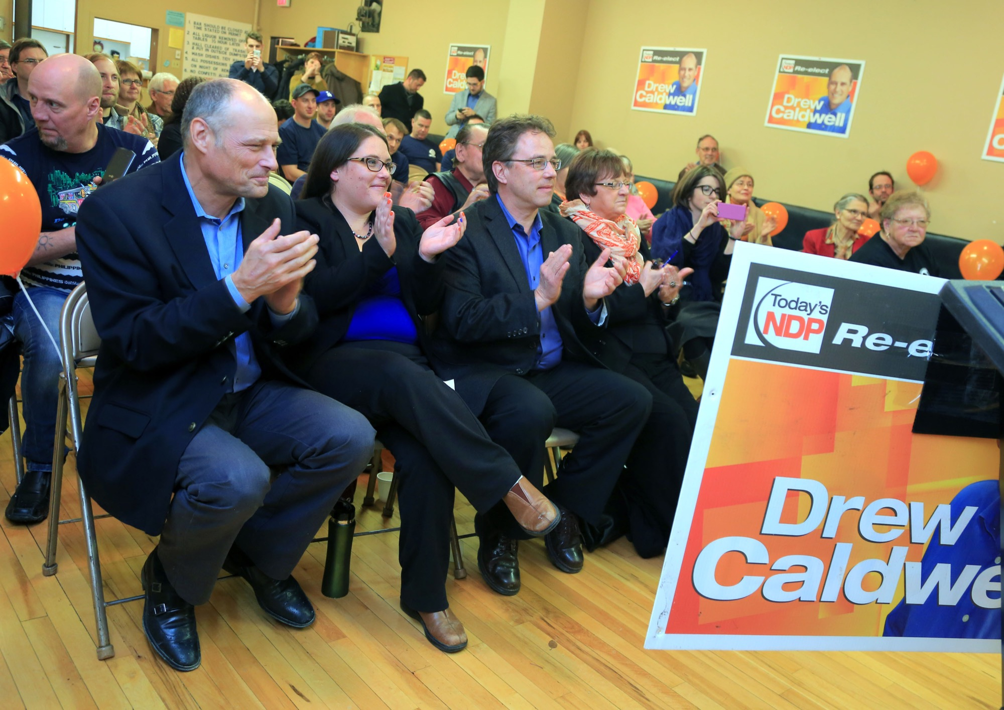 Caldwell, Lonnie Patterson and Interlake MLA Tom Nevakshonoff applaud during Caldwell's nomination meeting in 2016. Patterson praised NDP Leader Wab Kinew's decision to appoint a female-led commission to investigate the allegations against Struthers and to make recommendations on policy changes as a step in the right direction.