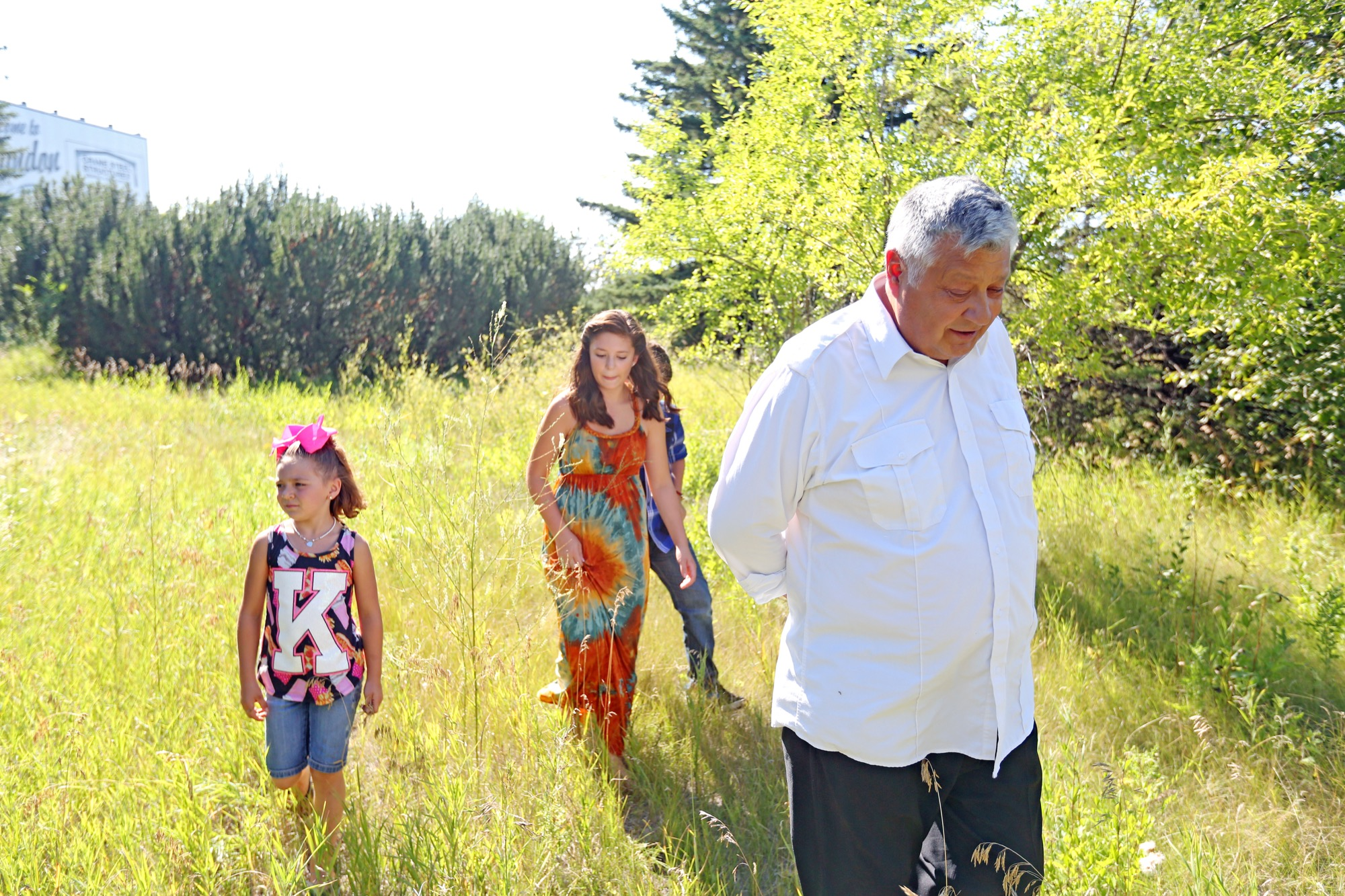 Gambler First Nation Chief David Ledoux walks through the future site of the development at 18th Street North and Clare Avenue with his grandkids Dawjae Smith, Emily Ledoux and Dylan Ledoux last August.