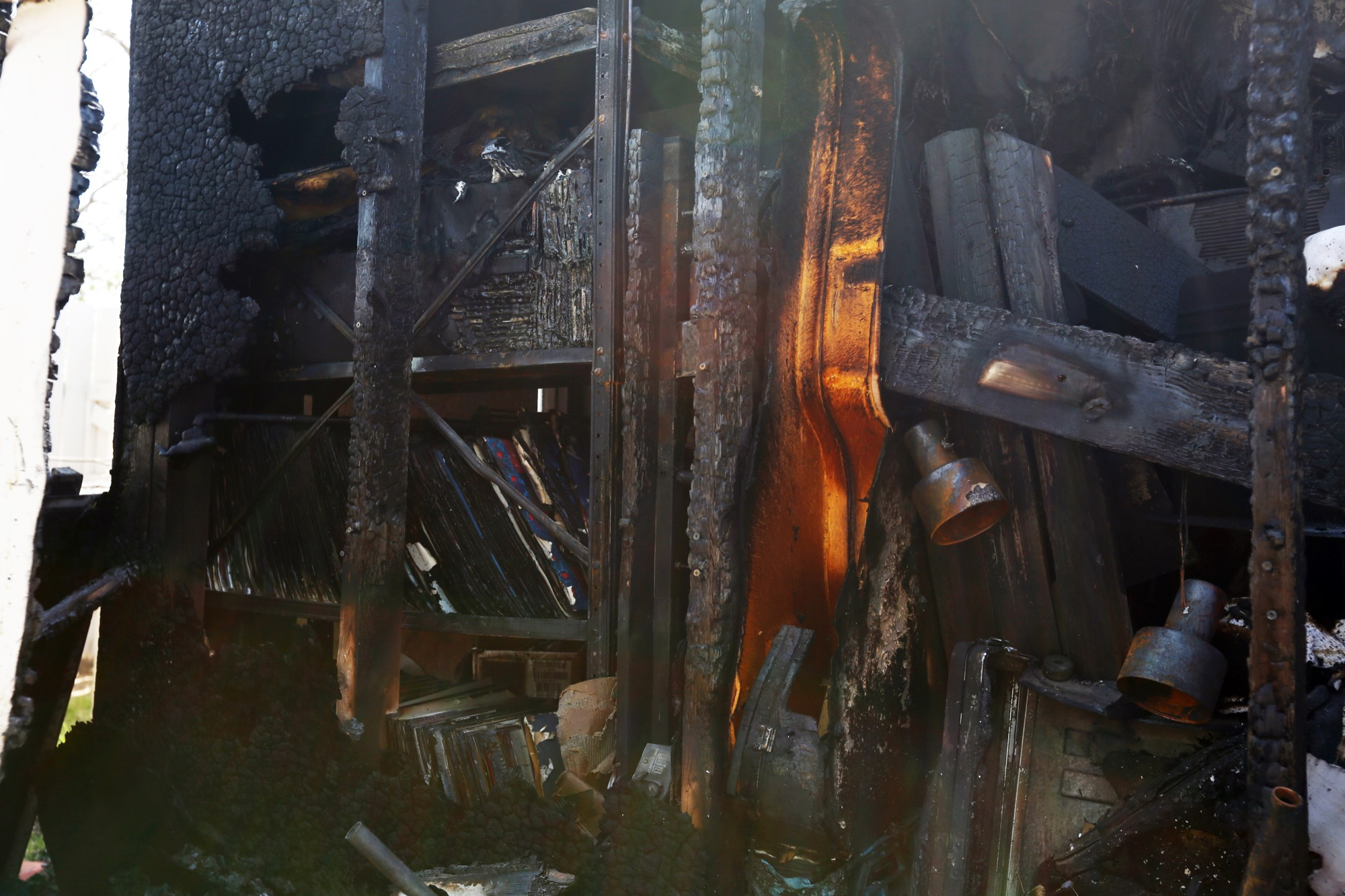 A closeup of the aftermath of Sunday's shed fire on Basswood Bay, revealing a collection of music equipment and records that were left damaged in its wake.
