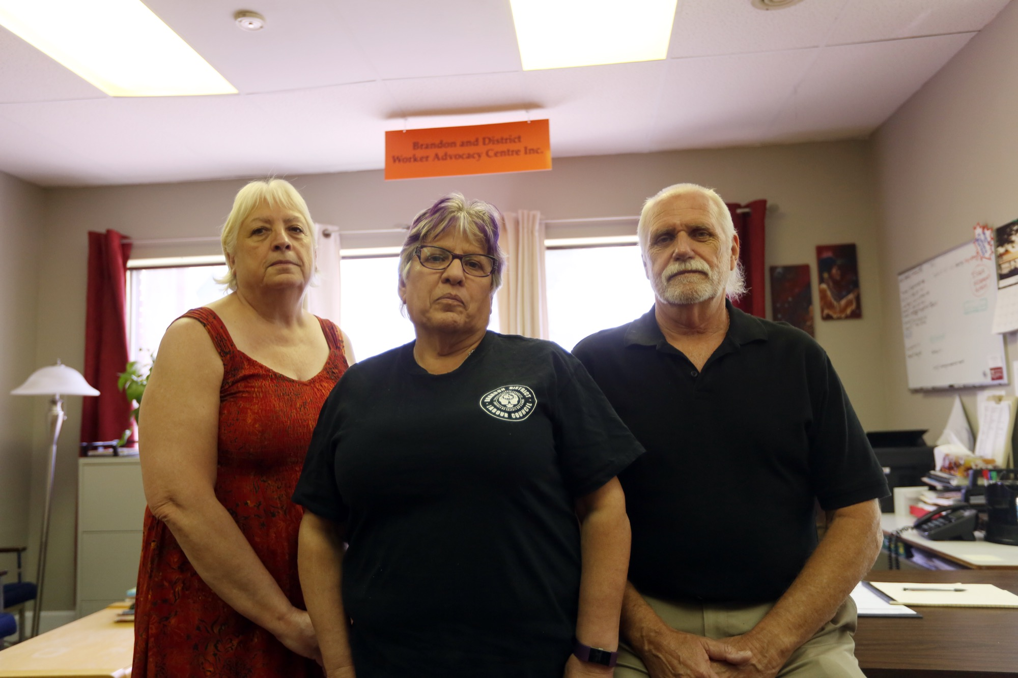 Brandon and District Worker Advocacy Centre Inc. advocate Susan Norman, left, president Kim Fallis and treasurer Garnet Boyd at a farewell event on Saturday. Established in 2012, the centre will close its doors later this month after the province rescinded its funding.