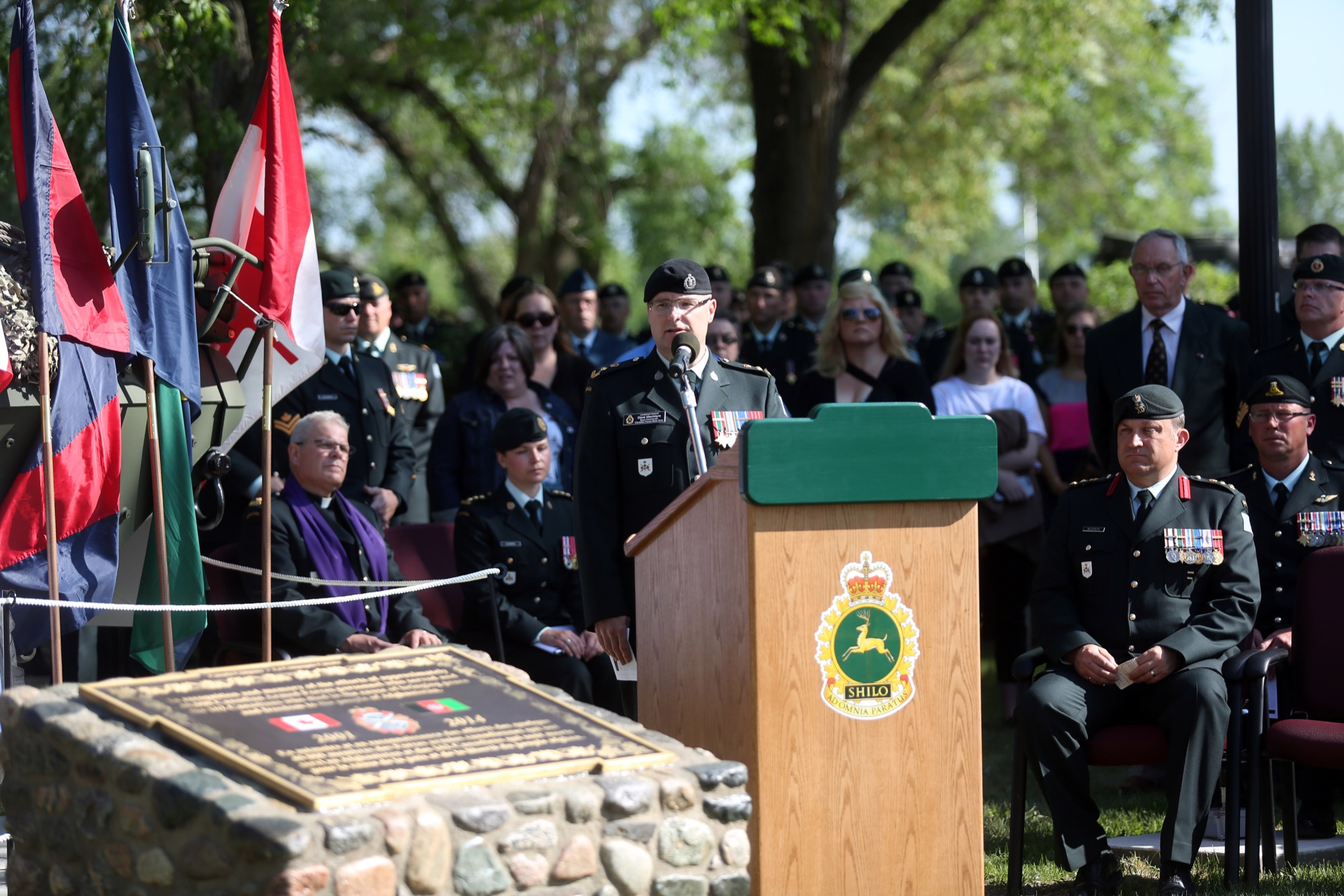 CFB Shilo commander Lt.-Col. Dave MacIntyre addresses the audience at Tuesday's dedication ceremony for the new Afghanistan Memorial at Canoe River Memorial Park.