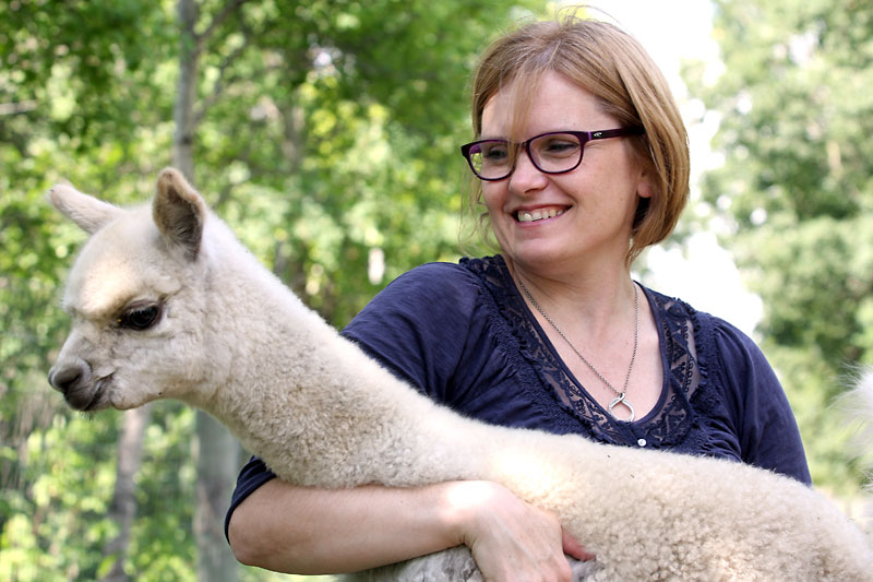 Christine Burton holds one of her baby alpacas on a beautiful Tuesday afternoon. Their farm is located just outside of Brandon.