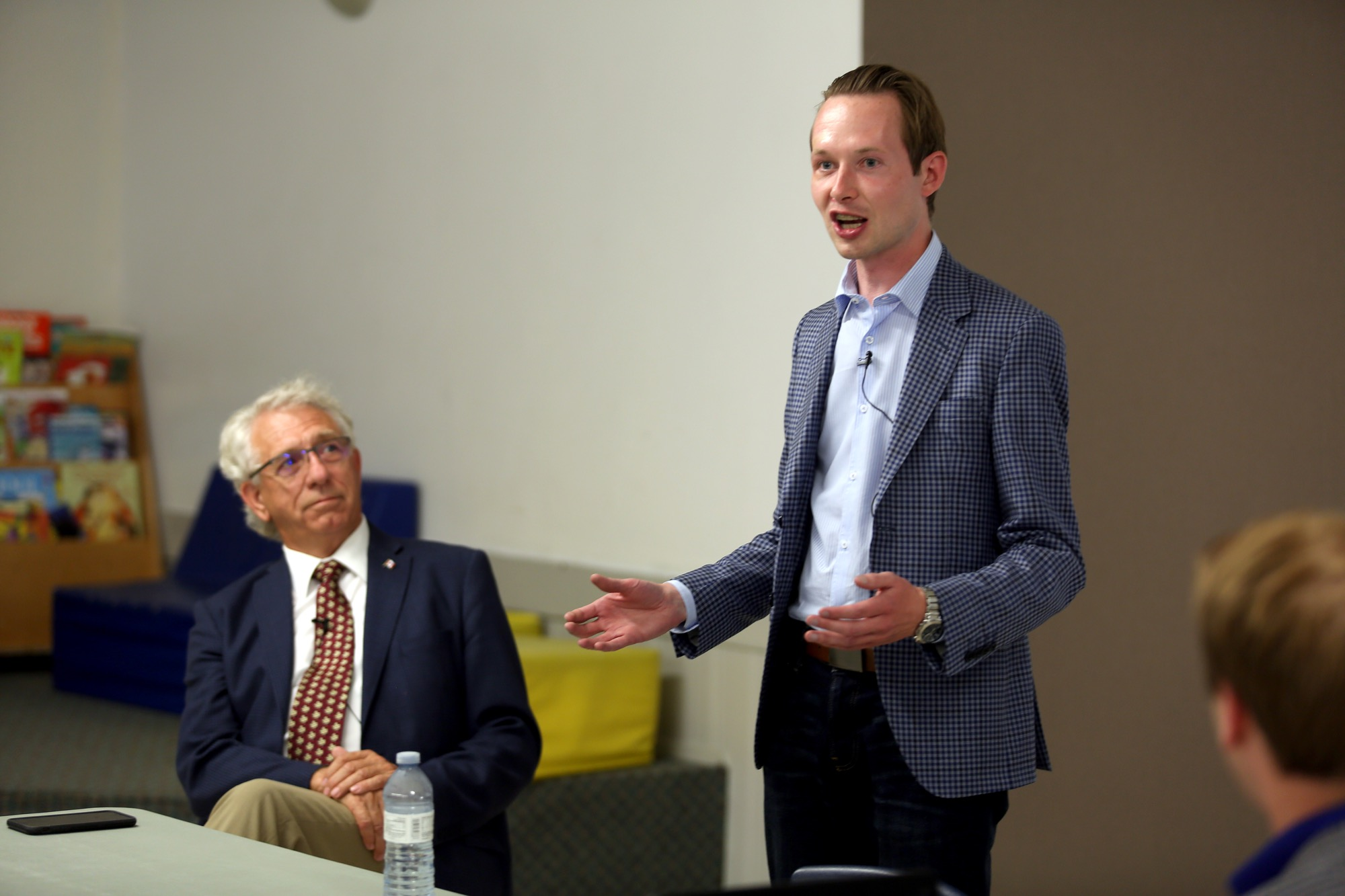 Conservative deputy justice critic Michael Cooper addresses justice issues as Brandon-Souris Conservative MP Larry Maguire looks on Tuesday night at Brandon's Westridge Community Centre.
