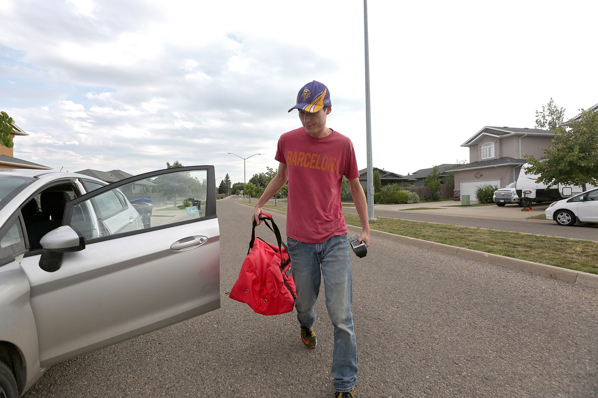 Dash! Dining and Entertainment driver Shaun Hewins delivers a Tokyo Zone meal at the south end of Brandon on Thursday.