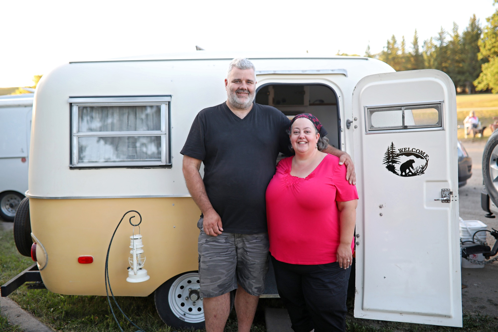 Shaun and Nicole Conkle of Victoria pose for a photo in front of their Boler camper at Grand Valley Campground just west of Brandon on Tuesday evening. A caravan of Boler enthusiasts headed east to Winnipeg from western Canada for the Boler 50th Anniversary celebration stopped in and around the Wheat City for the night on Tuesday. The Boler gathering in Winnipeg began Wednesday and is attracting Boler enthusiasts from all over North America.