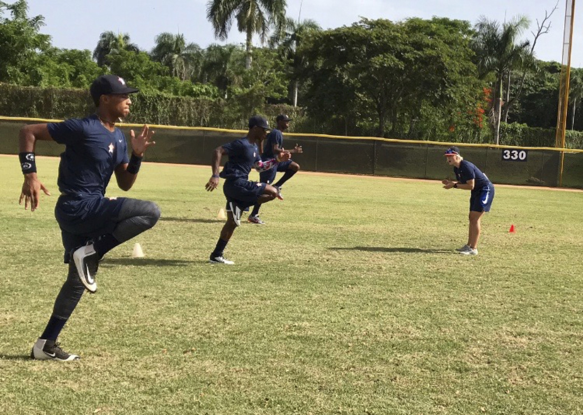Brandonite Brittany Wiebe, right, puts players with the Houston Astros' affiliate team in the Dominican Summer League through their paces. The Crocus Plains graduate is the team's strength and conditioning coach.