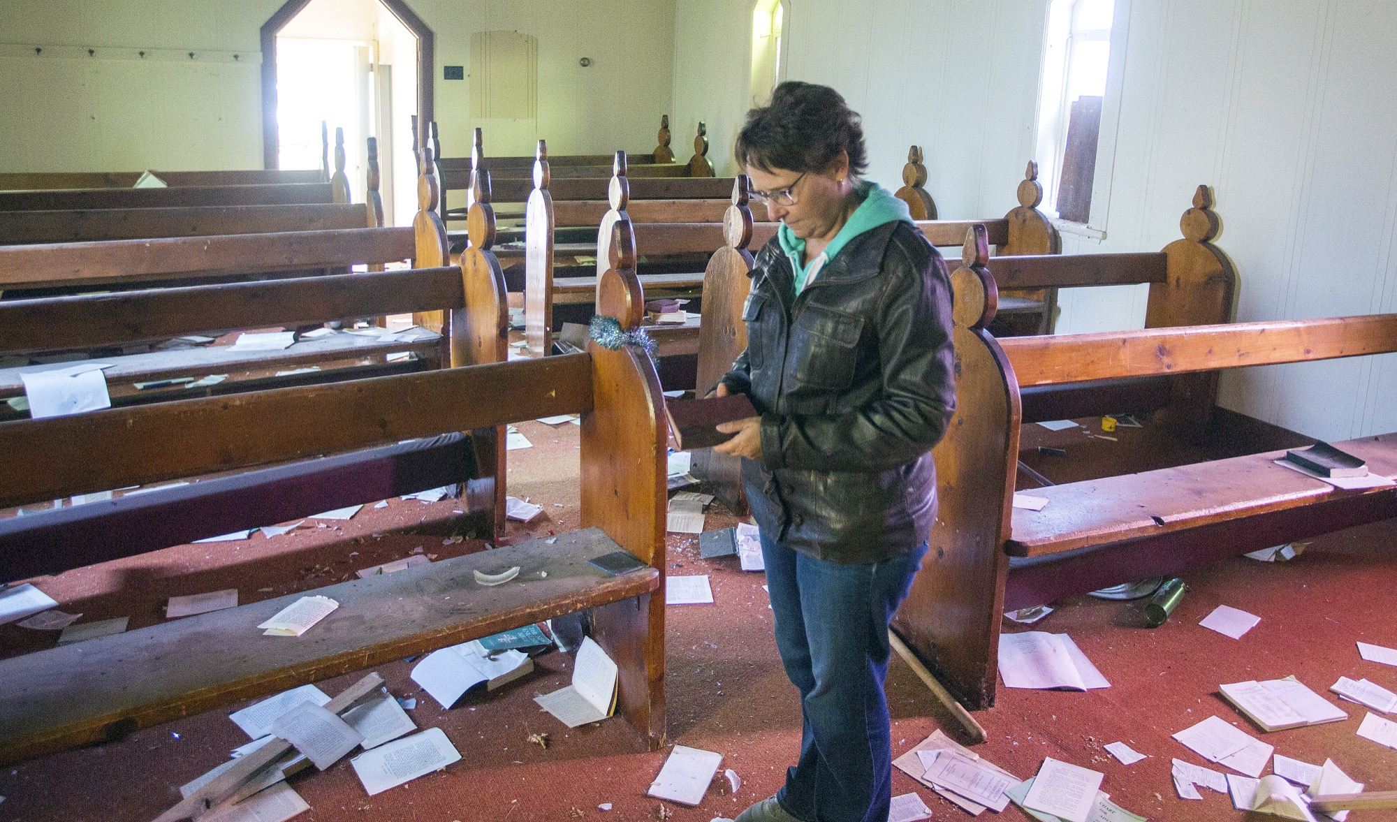 Shelley Meakin explores the vandalized St. Thomas Anglican church in Rapid City on Wednesday. The church was built in 1880 and is set to be demolished. The church has not held a service in more than a decade.
