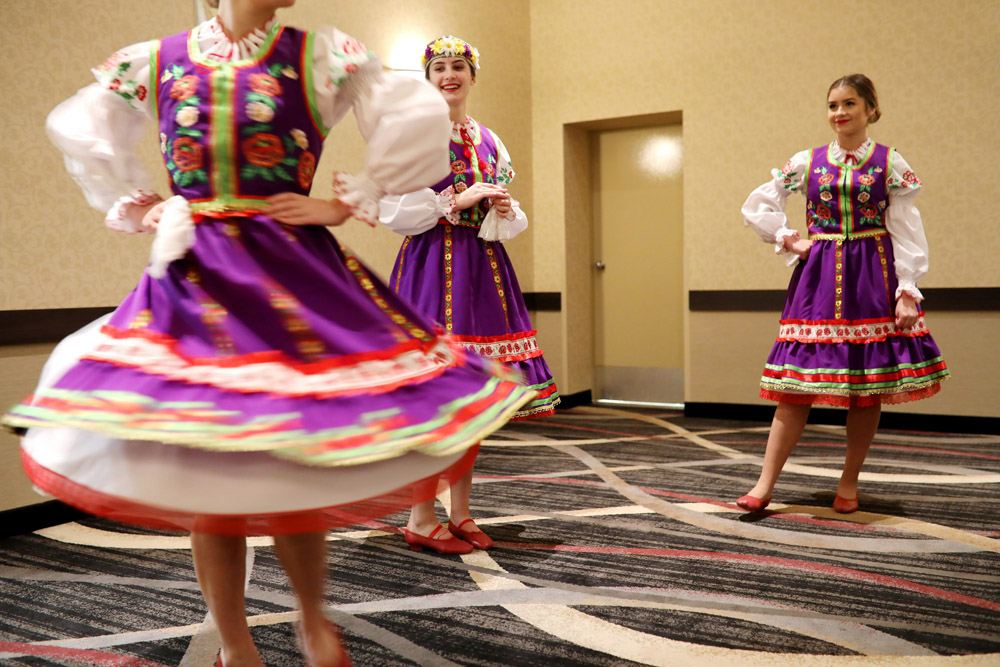 Angela Pasakas, centre, and Mariya Gavadzyn watch as Mikayla Kurchaba spins as the three Brandon Troyanda School of Unkrainian Dance members prepare for the school's Ukrainian New Years Malanka celebration at Victoria Inn's Imperial Ballroom on Friday evening. Malanka is a Ukrainian folk holiday traditionally celebrated on Jan. 13, which is New Year's Eve in accordance with the Julian calendar. (Tim Smith/The Brandon Sun)