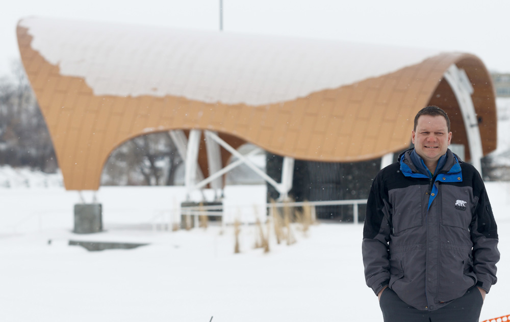 Brandon Riverbank Inc.'s general manager James Montgomery poses for a photo in front of the new amphitheatre in Festival Park Friday. (Chelsea Kemp/The Brandon Sun)