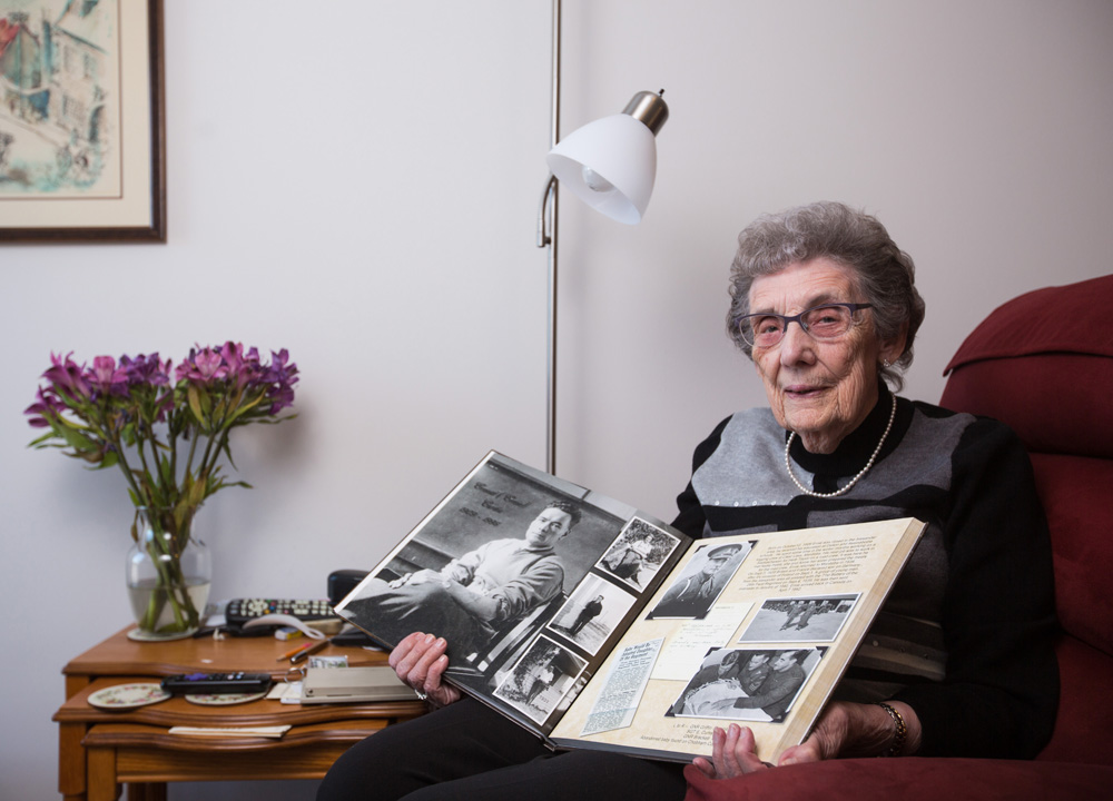 Winelda Curtis poses with a scrapbook commemorating the life of her late husband Ernie Curtis Saturday. (Chelsea Kemp/The Brandon Sun)