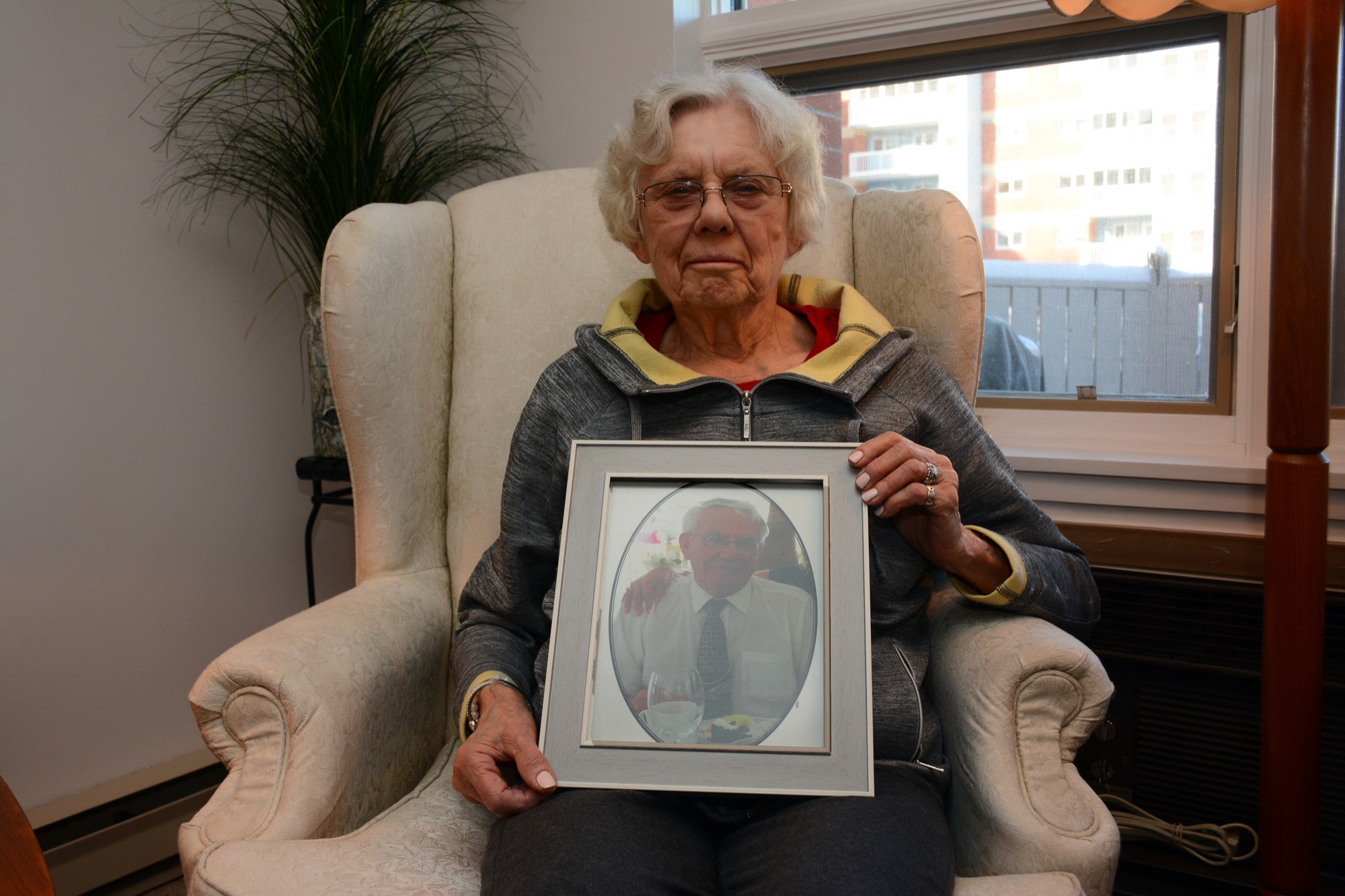 Joanne Malkowich holds a photo of her late husband, Steve, who portrayed Santa Claus for generations of Brandon children.