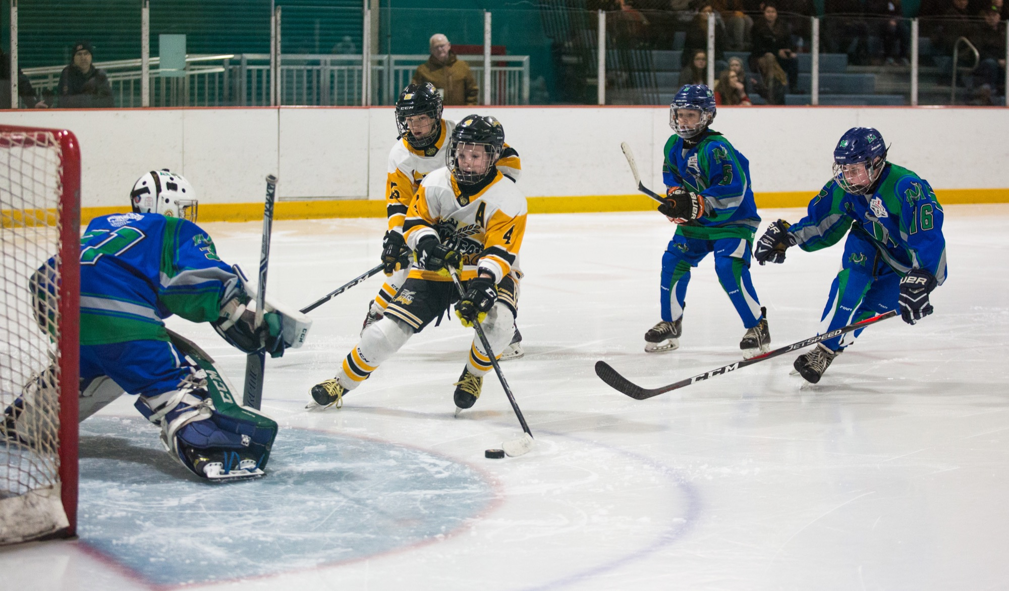 Pee Wee AA Brandon Wheat Kings player Clarke Caswell lines up a shot against the Melfort Mustangs during the Tournament of Champions in the Kinsmen Arena at the Keystone Centre on Saturday.