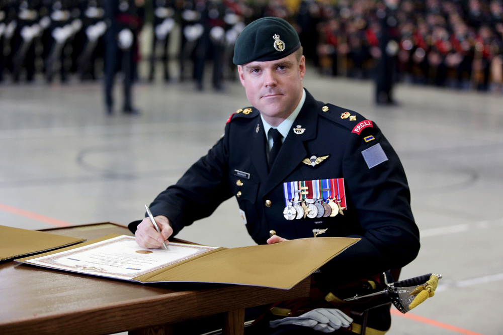 Lt.-Col. Jay MacKeen signs the change of command certificates during the change of command ceremony for 2nd Battalion, Princess Patricia�s Canadian Light Infantry. (Melissa Verge/The Brandon Sun)