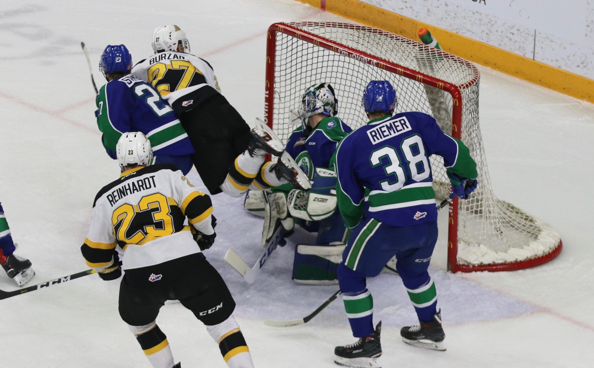 Brandon Wheat Kings forward Luka Burzan flies through the air as he scores the tying goal in the third period of a Western Hockey League game against the Swift Current Broncos on Monday at Westoba Place. Broncos goalie Isaac Poulter of Winnipeg is flanked by defenceman Garrett Sambrook of Medora (27) and Christian Riemer (38), along with Wheat Kings forward Cole Reinhardt, who scored the game winner in overtime.