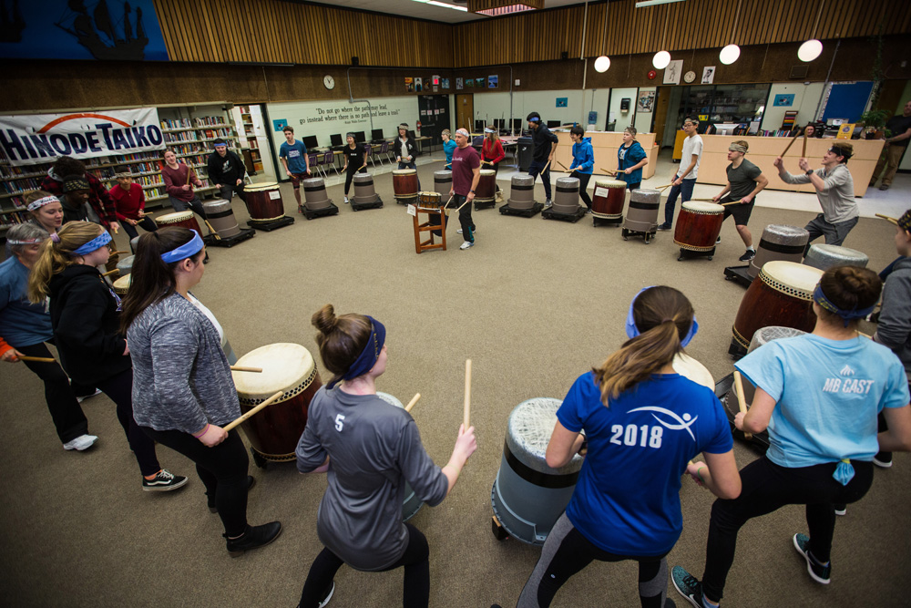 Jim Fedorowich, centre,  of Hinode Taiko teaches Grade 9 Vincent Massey High School students the art of the Japanese drum Thursday. (Chelsea Kemp/The Brandon Sun)