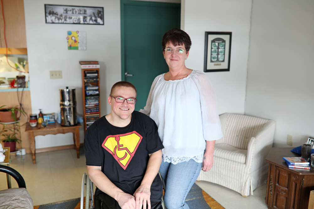 Tracy Williams (right) and Riley Day (not shown) are putting on a fundraiser for their friend Phillip Emmerson (left) to attend a wheelchair bodybuilding competition in Toronto. (Tim Smith/The Brandon Sun)