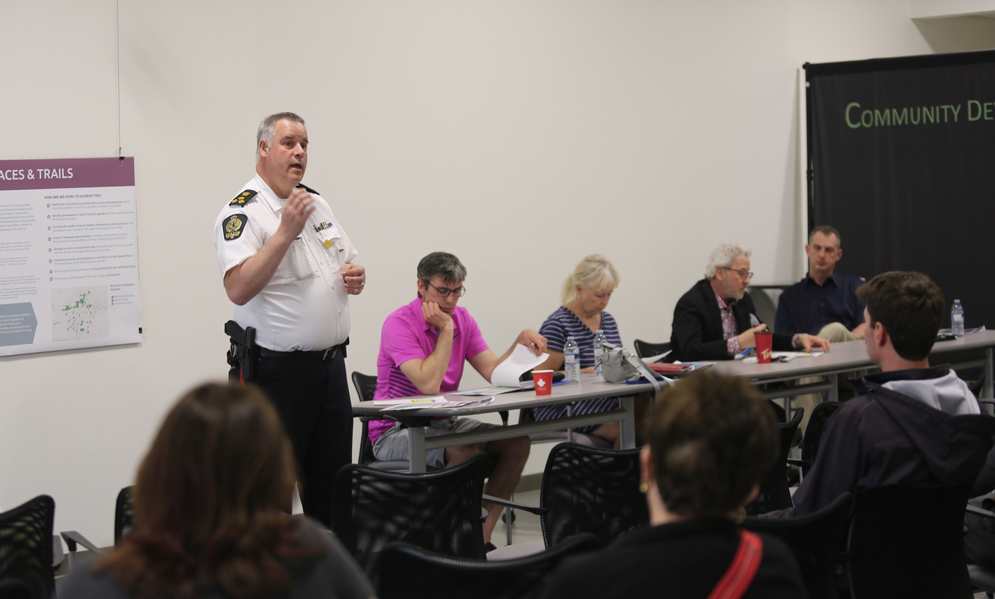 Brandon Police Service Chief Wayne Balcaen speaks to audience members at Monday's multi-ward meeting.