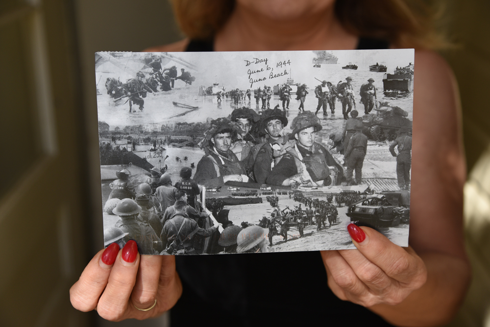 Jacqueline White holds a postcard telling her about the young soldier who used to live in the house she now lives in. The postcards were mailed out to commemorate the 75th anniversary of the Juno Beach campaign during the Second World War. (Bud Robertson/The Brandon Sun)