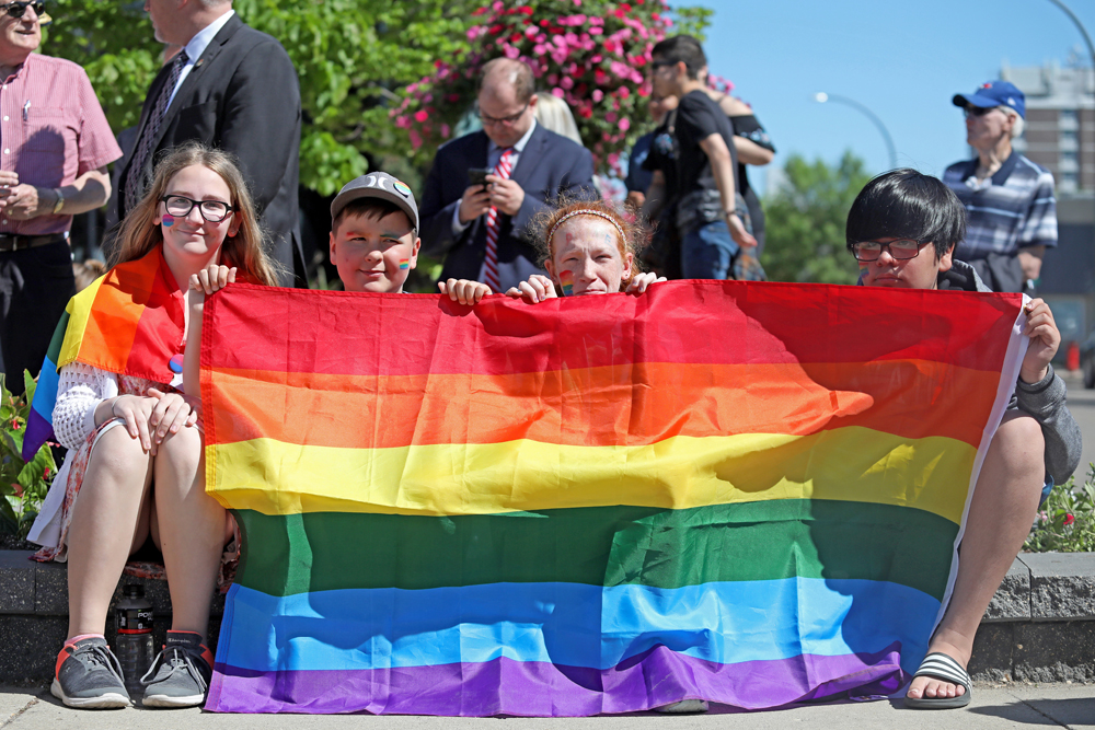 Riverheights School students Alex Dedieu, Leighton Berry, Kateri Mills and Isaiah Johnson hold a Pride flag during the flag raising at Brandon City Hall on Monday to kick off Brandon's 10th annual Pride Week. See Page A4 for story. (Tim Smith/The Brandon Sun)