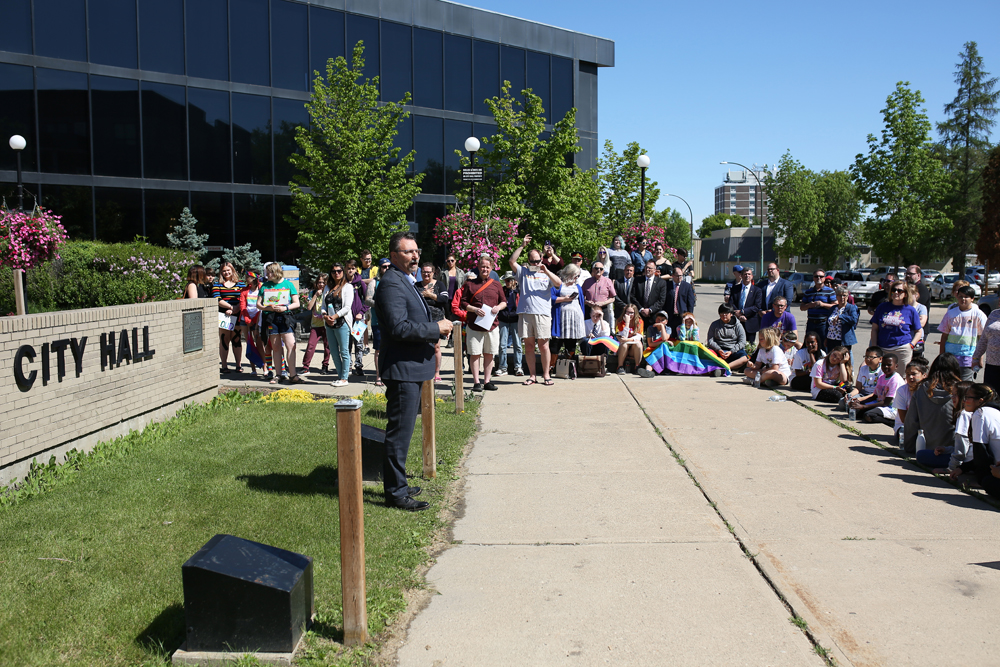 Brandon Mayor Rick Chrest speaks during the raising of the Pride flag at Brandon City Hall on Monday to kick off Brandon's 10th Annual Pride Week. (Tim Smith/The Brandon Sun)