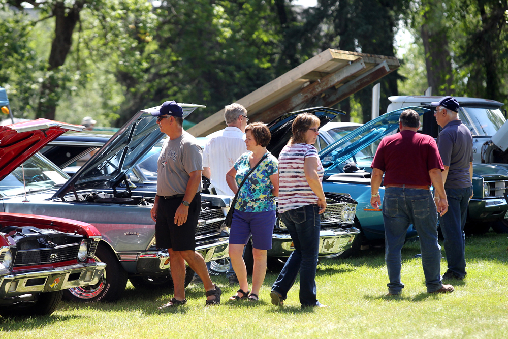 Visitors to the Super Run 2016 automotive show check out rows of classic cars at the Keystone Centre grounds. (File)