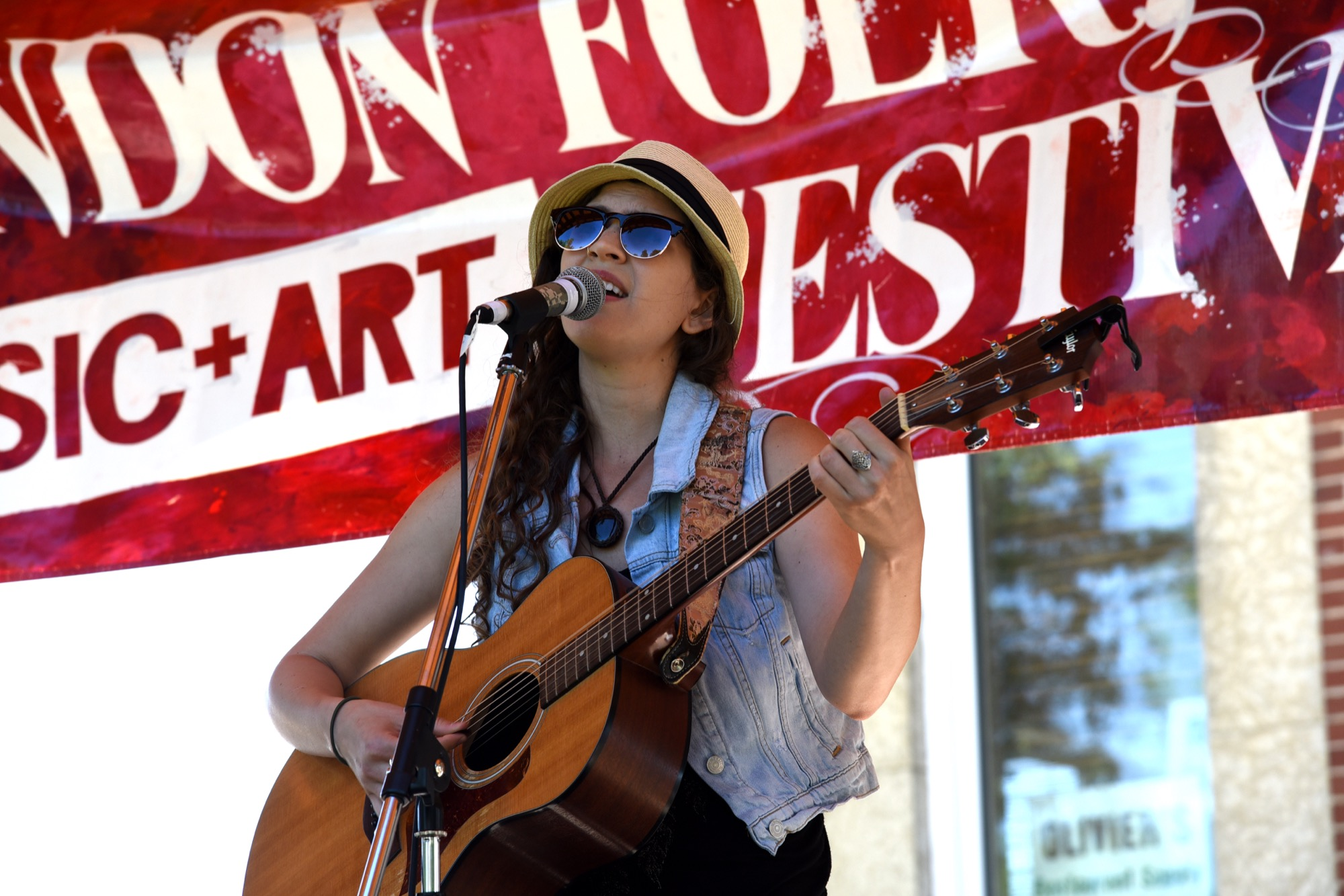 Mimi Vouk, a singer-songwriter from Winnipeg, performs at the 35th Brandon Folk, Music and Art Festival Saturday in Princess Park.