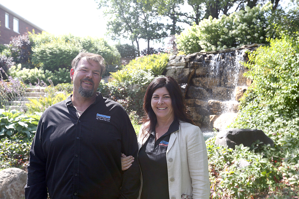 Chris and Karin Griffin of Alternative Landscaping show off the project that has won them a national landscaping award. (Colin Slark/The Brandon Sun)