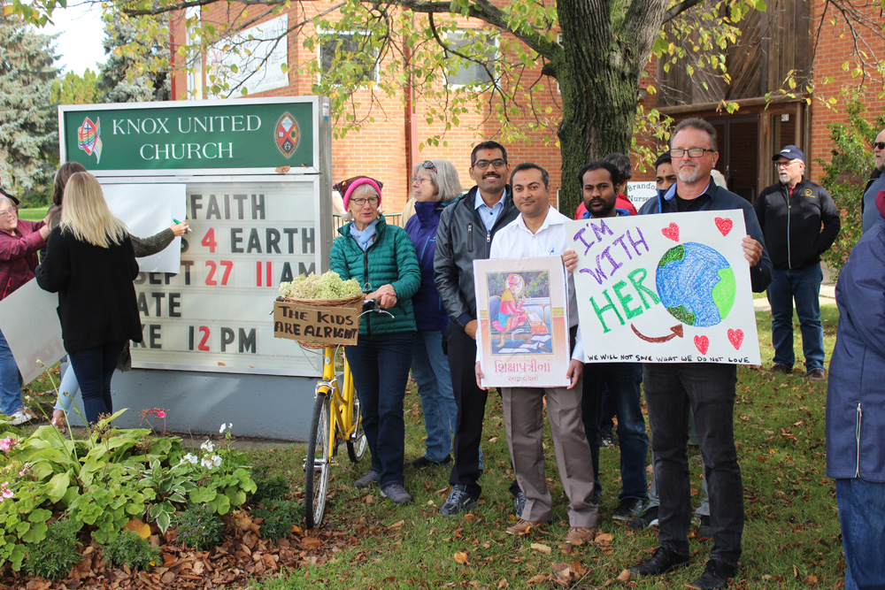 Members of the Knox United Church took part in an interfaith climate protest on Friday morning to stand in solidarity with the various other climate strikes happening across the globe. (Kyle Darbyson/The Brandon Sun)