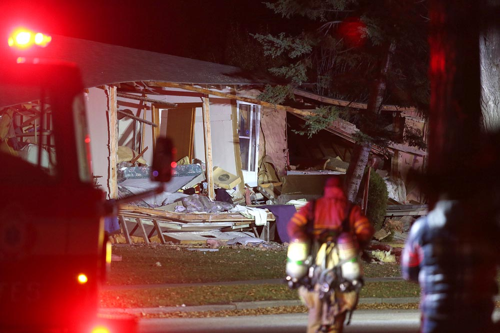 Emergency personnel respond to the scene of what was likely a natural gas explosion on the 200 block of Queens Avenue in Brandon on Tuesday evening at approximately 9 p.m. (Tyler Clarke/The Brandon Sun)