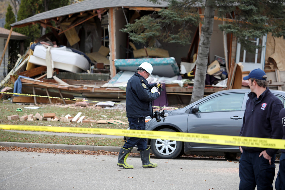 Police tape surrounds a home on the 200 block of Queens Avenue East on Wednesday as the investigation continues into an explosion at the home on Tuesday evening. (Tim Smith/The Brandon Sun)